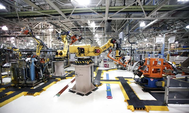 Robots at the Fiat Chrysler Automobiles US Warren Stamping Plant are seen in Michigan (AFP Photo/Bill Pugliano)