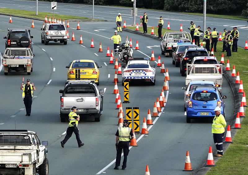 Checkpoints on the Gold Coast Highway on Thursday morning. Source: AAP