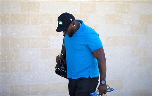 Boston Red Sox's David Ortiz leaves the clubhouse after meeting with trainers at spring training baseball, Sunday, March 10, 2013, in Fort Myers, Fla. (AP Photo/David Goldman)