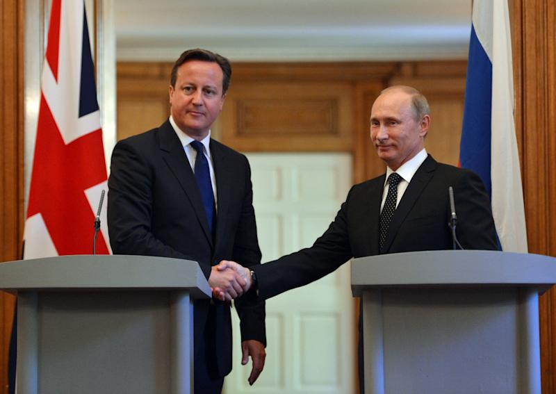 British Prime Minister David Cameron, left, shakes hands with Russian President Vladimir Putin, during a press conference at 10 Downing Street, London, Sunday June 16, 2013. Cameron meets with Russian President Putin for talks on the Syrian crisis amid fears that differences between Moscow and the West are pushing the two sides towards a new Cold War. (AP/Anthony Devlin, PA Wire) UK OUT - NO SALES - NO ARCHIVES