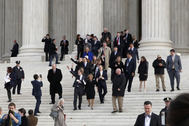 <p>Jack Phillips, center left and next to attorney Kristen Waggoner, waves to supporters as they leave the Supreme Court 'Masterpiece Cakeshop v. Colorado Civil Rights Commission' case, Tuesday, Dec. 5, 2017, in Washington. (Photo: Jacquelyn Martin/AP) </p>