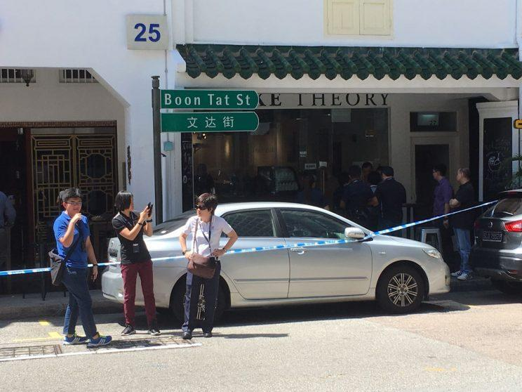 Police respond to an incident at Boon Tat street on Monday (10 July). Photo: Gabriel Choo/Yahoo Singapore