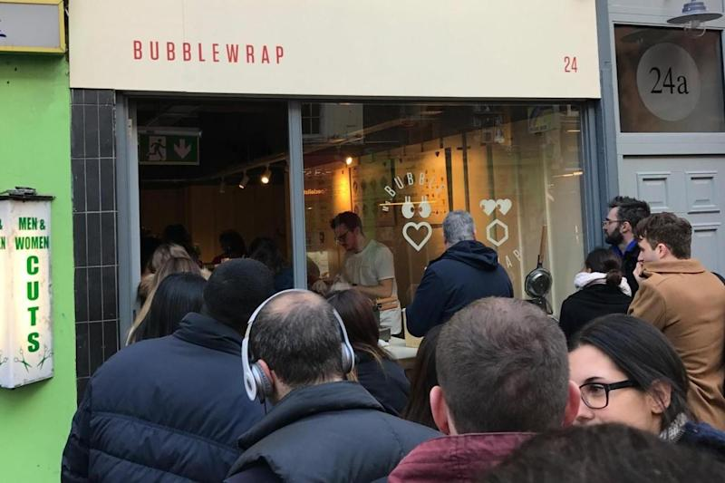 Sweet treat: Londoners queue up to get their hands on one of the tasty desserts
