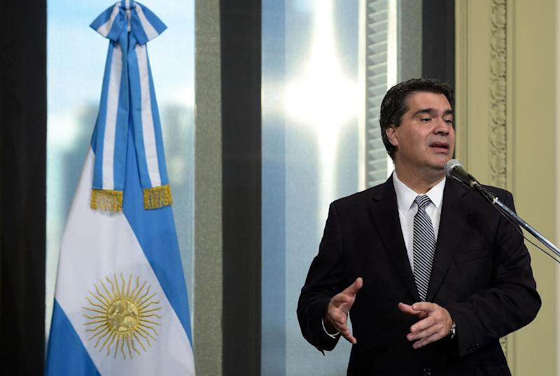 Argentina's Cabinet Chief Jorge Capitanich talks to the press on Juy 30, 2014 in Buenos Aires