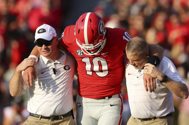 "Georgia quarterback <a class=""link rapid-noclick-resp"" href=""/ncaaf/players/264537/"" data-ylk=""slk:Jacob Eason"">Jacob Eason</a> leaves the NCAA college football game against Appalachian State with an injury during the first quarter Saturday, Sept. 2, 2017, in Athens, Ga. (Curtis Compton/Atlanta Journal-Constitution via AP)"