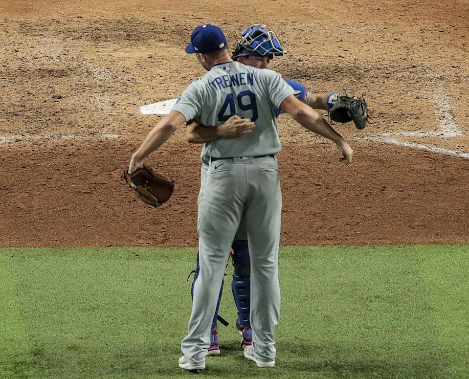 Reliever Blake Treinen celebrates with catcher Will Smith after recording a save against the Tampa Bay Rays.