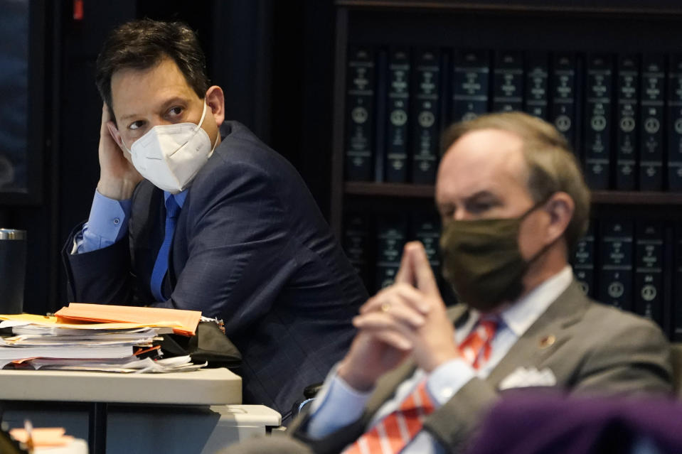 Virginia State Sen. Scott Surovell, D-Fairfax, left, listens along with Sen. Lynwood Lewis, D-Accomack, right, during debate on a bill calling for the removal of the statue of former Sen. Harry Byrd from Capitol Square during the Senate session at the Science Museum of Virginia in Richmond, Va., Tuesday, Feb. 23, 2021. (AP Photo/Steve Helber)