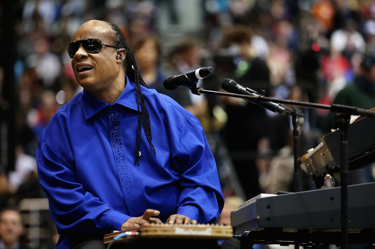 "CINCINNATI, OH - NOVEMBER 04: Stevie Wonder warms up the crowd during a campaign rally for President Barack Obama at Fifth Third Arena November 4, 2012 in Cincinnati, Ohio. With only two days left in the presidential election, Obama and his opponent, former Massachusetts Gov. Mitt Romney are stumping from one ""swing state"" to the next in a last-minute rush to persuade undecided voters. (Photo by Chip Somodevilla/Getty Images)"