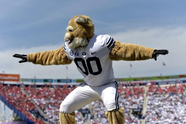 "BYU mascot Cosmo performs during the game between the <a class=""link rapid-noclick-resp"" href=""/ncaab/teams/wbg/"" data-ylk=""slk:Wisconsin Badgers"">Wisconsin Badgers</a> and the Brigham Young Cougars at LaVell Edwards Stadium on September 16, 2017 in Provo, Utah. (Getty Images)"