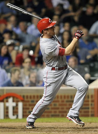 Cincinnati Reds' Zack Cozart watches his three-run home run against the Chicago Cubs during the eighth inning of a baseball game on Tuesday, June 11, 2013, in Chicago. (AP Photo/Jim Prisching)