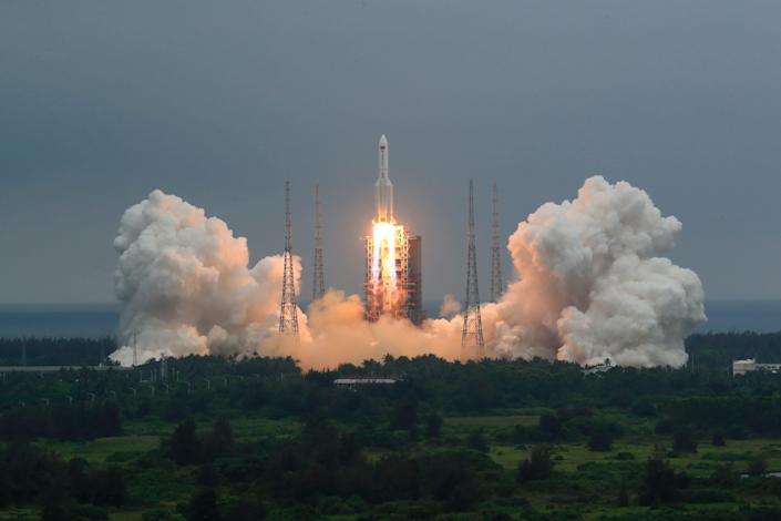 In this April 29, 2021, file photo released by China's Xinhua News Agency, a Long March 5B rocket carrying a module for a Chinese space station lifts off from the Wenchang Spacecraft Launch Site in Wenchang in southern China's Hainan Province. The central rocket segment that launched the 22.5-ton core of China's newest space station into orbit is due to plunge back to Earth as early as Saturday in an unknown location.