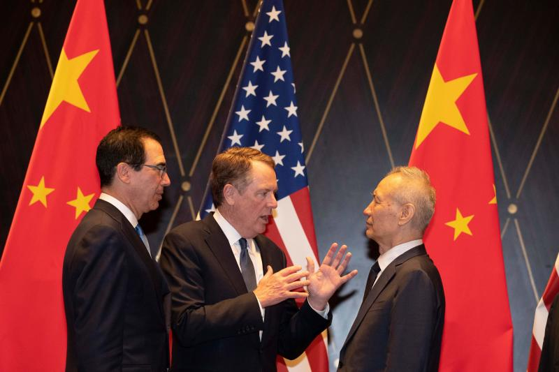 "United States Trade Representative Robert Lighthizer (C) gestures as he chats with Chinese Vice Premier Liu He (R) as US Treasury Secretary Steven Mnuchin (L) looks on after posing for a ""family photo"" at the Xijiao Conference Centre in Shanghai on July 31, 2019. - Chinese and US negotiators held talks in Shanghai on July 31 in a bid to bring an end to a year-long trade war, with the meeting overshadowed by a Twitter tirade from President Donald Trump. (Photo by Ng Han Guan / POOL / AFP) (Photo credit should read NG HAN GUAN/AFP via Getty Images)"