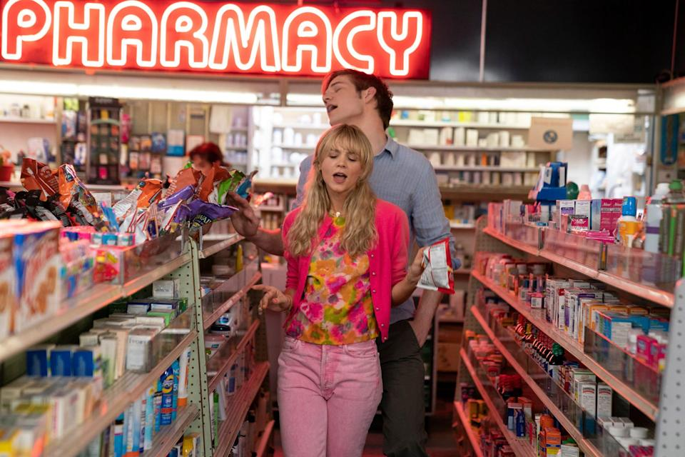 """Cassie (Carey Mulligan) and Ryan (Bo Burnham) bond over a Paris Hilton song in a pharmacy in """"Promising Young Woman."""""""