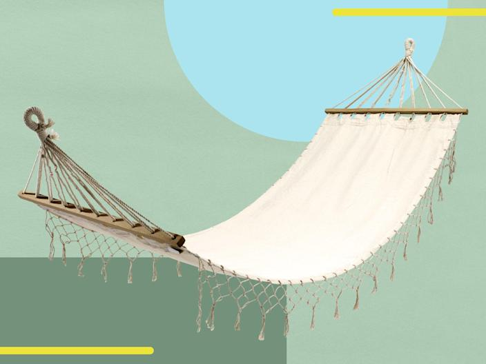 <p>Whether hanging between trees or on its own stand, a hammock is the ideal garden addition</p> (iStock/The Independent)