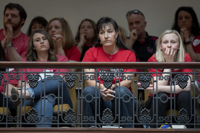 <p>Teachers look on as The Senate votes on bills for increased funding and to changes to their state funded pension system, Friday, April 13, 2018, in Frankfort, Ky. (Photo: Bryan Woolston/AP) </p>