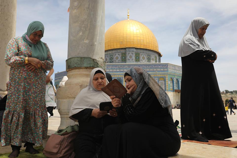 Palestinian women take part in the last Friday prayers of the Islamic holy month of Ramadan at the Dome of the Rock Mosque on May 7, 2021.