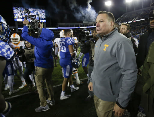 Tennessee head coach Butch Jones walks on the field after his team was defeated by Kentucky 29-26, Saturday, Oct. 28, 2017, in Lexington, Ky. (AP Photo/David Stephenson)