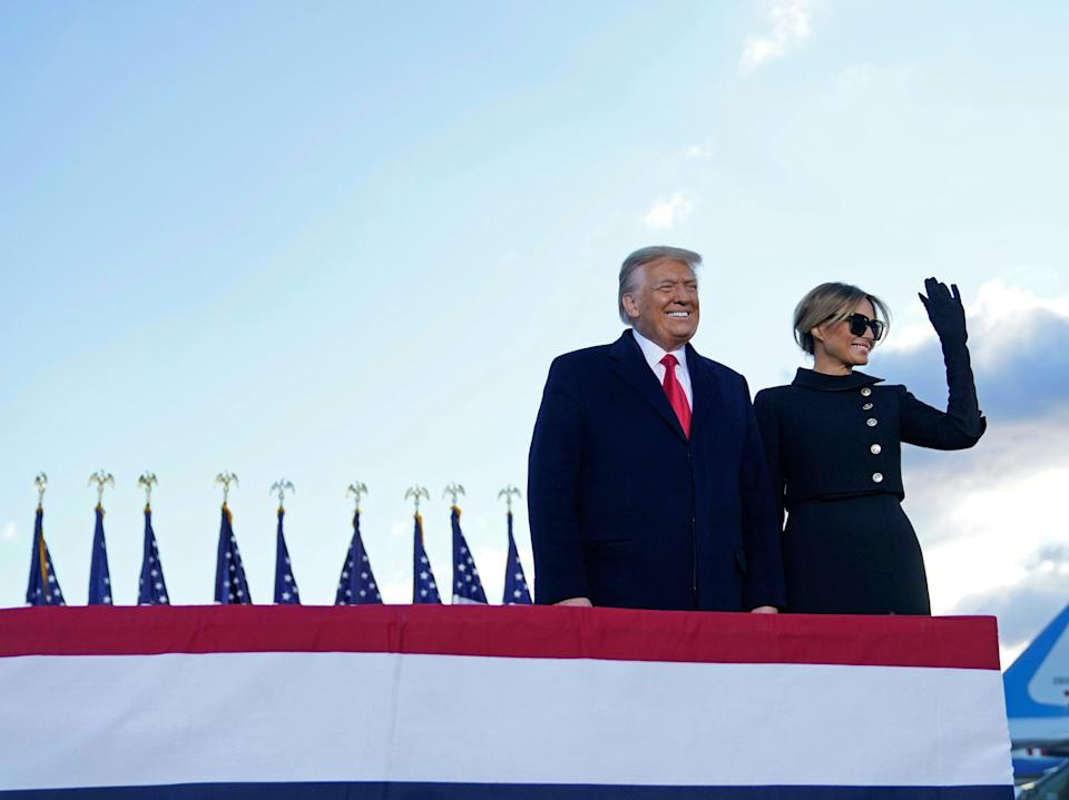 Donald Trump and Melania Trump at Joint Base Andrews in Maryland before heading to their Mar-a-Lago club in Palm Beach, Florida. Mr Trump is the first president in 152 years to refuse to attend the inauguration of their successorAFP via Getty Images