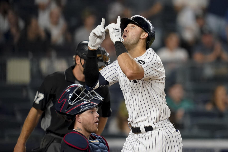 New York Yankees' Joey Gallo gestures as he crosses home plate after hitting a solo home run off Cleveland Indians starting pitcher Zach Plesac during the second inning of a baseball game Friday, Sept. 17, 2021, in New York. (AP Photo/John Minchillo)