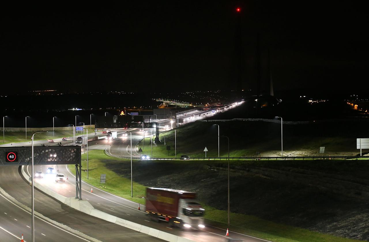 <p>Traffic makes its way along the southbound carriage as it leaves the Queensferry Crossing. (PA) </p>