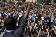 FILE - In this May 30, 2020, file photo, protesters gather in Minneapolis. Almost six months after the death of George Floyd, criminal justice reform advocates are cheering multiple victories in the 2020 election. (AP Photo/John Minchillo, File)