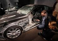 "A damaged Aston Martin DB5 from the James Bond film ""Quantum of Solace"" is displayed at the opening of the ""Bond in Motion: 50 Vehicles 50 Years"" exhibition at the National Motor Museum in Beaulieu, southern England January 15, 2012. REUTERS/Suzanne Plunkett"
