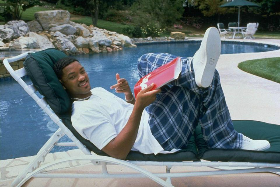 <p>Will Smith sitting in a lounge chair by the pool at his home in Los Angeles, CA in 1996.</p>