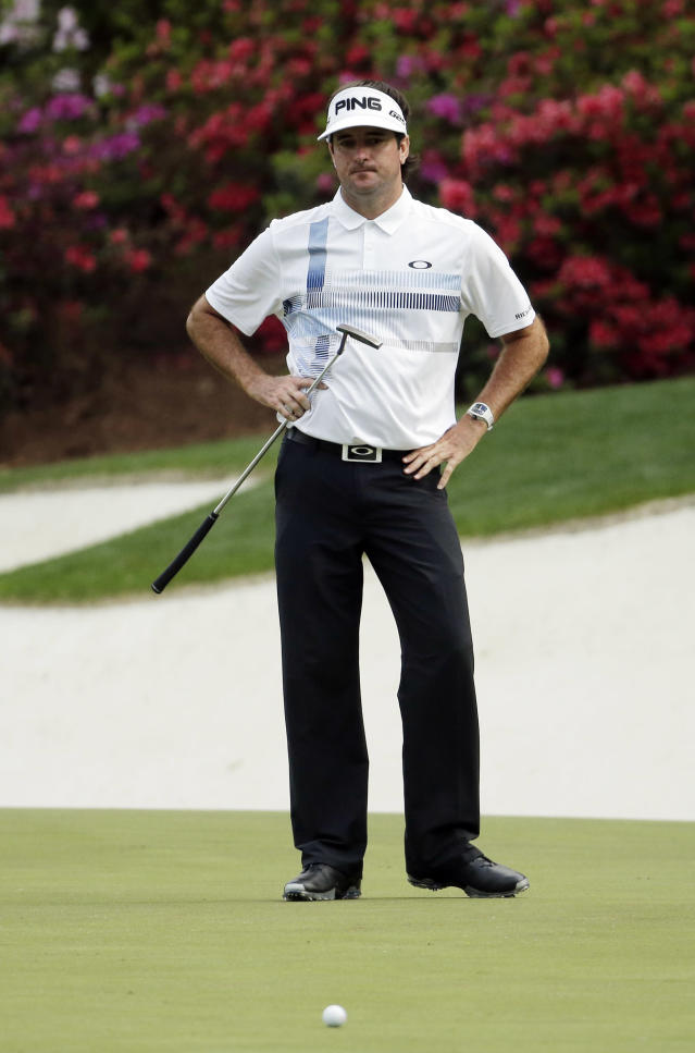 Bubba Watson looks at his ball after missing an eagle putt on the 13th green during the fourth round of the Masters golf tournament Sunday, April 13, 2014, in Augusta, Ga. (AP Photo/Chris Carlson)