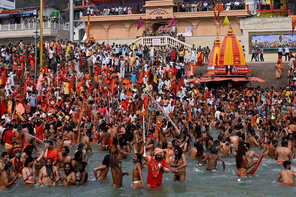 <p>Naga Sadhus (Hindu holy men) take a holy dip in the waters of the Ganges River during the ongoing religious Kumbh Mela festival, in Haridwar, as Covid-19 cases continue to surge in the country </p> (Getty Images)
