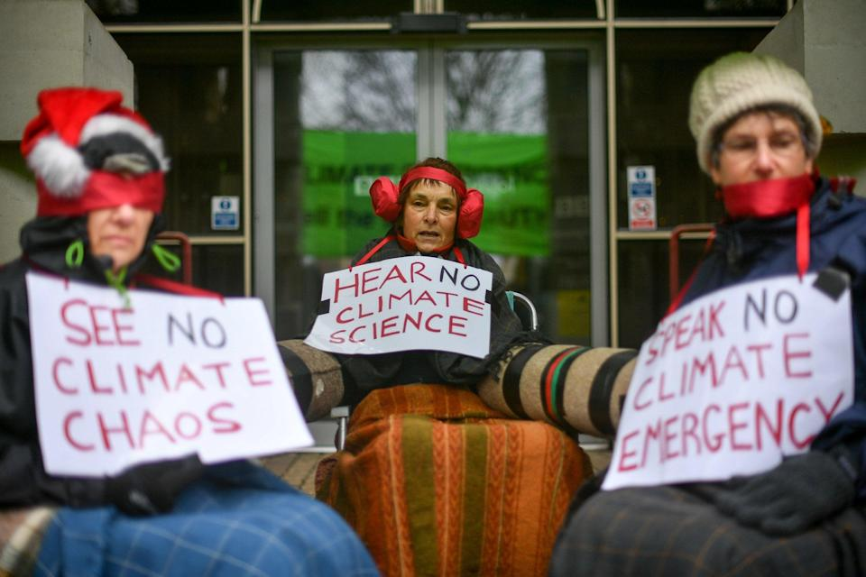 Climate change activists chain themselves together outside the BBC Bristol building (PA)