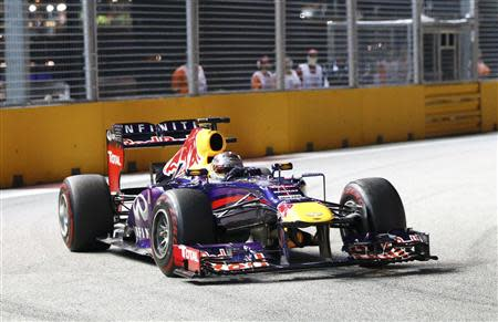 Red Bull Formula One driver Sebastian Vettel of Germany races during the Singapore F1 Grand Prix at the Marina Bay street circuit in Singapore September 22, 2013. REUTERS/Natashia Lee