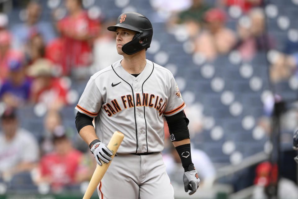 San Francisco Giants' Buster Posey looks on during the first baseball game of a doubleheader against the Washington Nationals, Saturday, June 12, 2021, in Washington. This game is a makeup of a postponed game from Thursday. (AP Photo/Nick Wass)