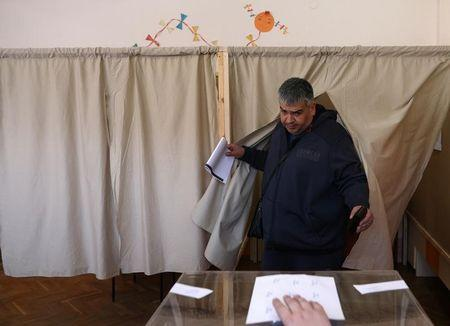 A man votes in a polling station during parliamentary elections in Sofia, Bulgaria March 26, 2017.  REUTERS/Stoyan Nenov