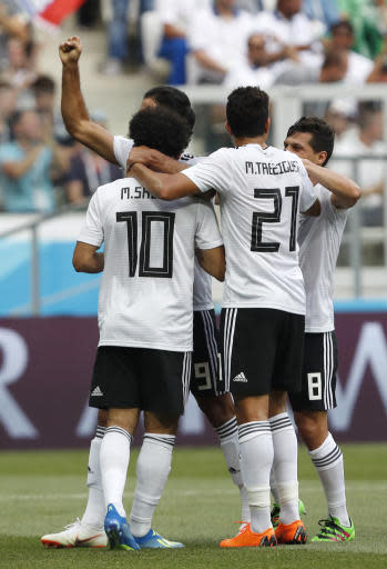 Egypt's Mohamed Salah, 10, is congratulated by his teammates after scoring the opening goal during the group A match between Saudi Arabia and Egypt at the 2018 soccer World Cup at the Volgograd Arena in Volgograd, Russia, Monday, June 25, 2018. (AP Photo/Darko Vojinovic)
