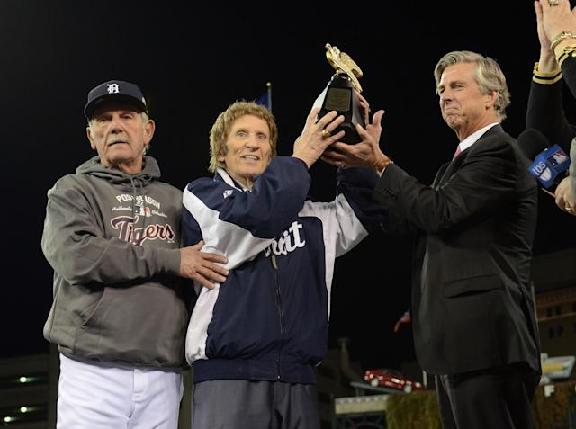 Tigers and Red Wings owner Mike Ilitch (center) died Friday at the age of 87. (Getty Images)