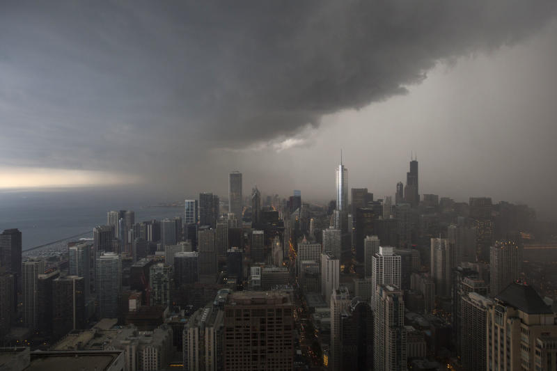 FILE - In this June 24, 2013 file photo, storm clouds pass over downtown Chicago. The federal government shutdown may have seemed like a frustrating squabble in far-off Washington, but in Chicago, it crept into our lives in small, subtle ways _ from missed vegetable inspections to inaccessible federal websites. (AP Photo/Scott Eisen)