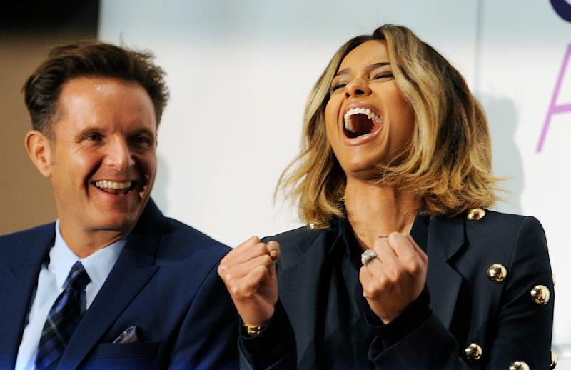 Ciara, right, reacts to her nomination for Favorite R&B Artist as fellow presenter Mark Burnett looks on during nominations for the 40th Annual People's Choice Awards at The Paley Center for Media on Tuesday, Nov. 5, 2013 in Beverly Hills, Calif. The show will be held on Jan. 8, 2014 at the Nokia Theater L.A. Live in Los Angeles. (Photo by Chris Pizzello/Invision/AP)