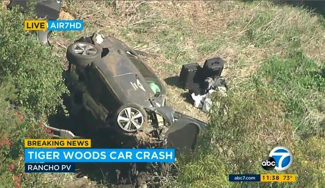 "In this aerial image take from video provided by KABC-TV video, a vehicle rest on its side after a rollover accident involving golfer Tiger Woods along a road in the Rancho Palos Verdes section of Los Angeles on Tuesday, Feb. 23, 2021. Woods had to be extricated from the vehicle with the ""jaws of life"" tools, the Los Angeles County Sheriff's Department said in a statement. Woods was taken to the hospital with unspecified injuries. The vehicle sustained major damage, the sheriff's department said. (KABC-TV via AP)"