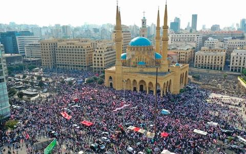 Tens of thousands of Lebanese continued rallying, demanding a sweeping overhaul of Lebanon's political system, citing grievances ranging from austerity measures to poor infrastructure. - Credit: AFP