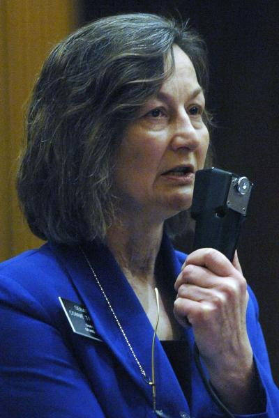 North Dakota state Sen. Bonnie Triplett, D-Grand Forks, speaks out against HB1305 before leaving the chamber without casting a vote on the bill at the state Capitol, Friday, March 15, 2013 in Bismarck, N.D. The North Dakota Senate overwhelmingly approved two anti-abortion bills Friday, one banning abortions as early as six weeks into a pregnancy and another prohibiting the procedure because of genetic defects such as Down syndrome. If the governor signs the measures, North Dakota would be the only state in the U.S. with those laws (AP Photo/The Bismarck Tribune, Mike McCleary)