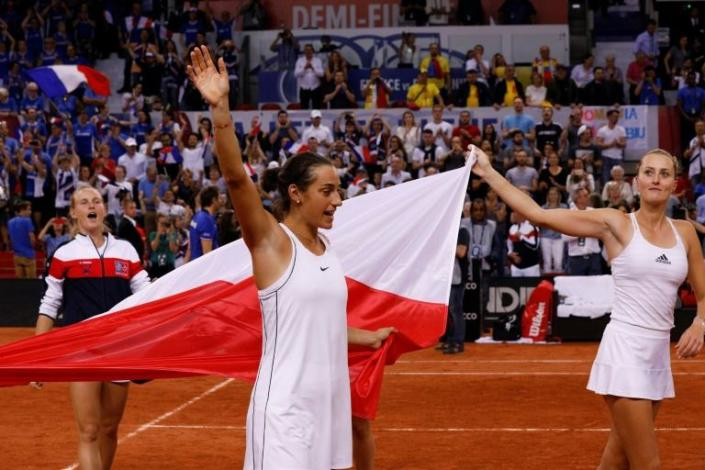 Team leaders: France's Kristina Mladenovic (right) and Caroline Garcia celebrate their Fed Cup semi-final win over Romania that put them into the final against Australia (AFP Photo/GEOFFROY VAN DER HASSELT)