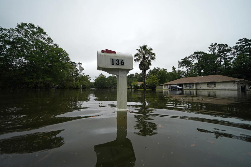 A flooded neighborhood is seen after Tropical Storm Claudette passed through in Slidell, La., Saturday, June 19, 2021. The National Hurricane Center declared Claudette organized enough to qualify as a named storm early Saturday, well after the storm's center of circulation had come ashore southwest of New Orleans. (AP Photo/Gerald Herbert)