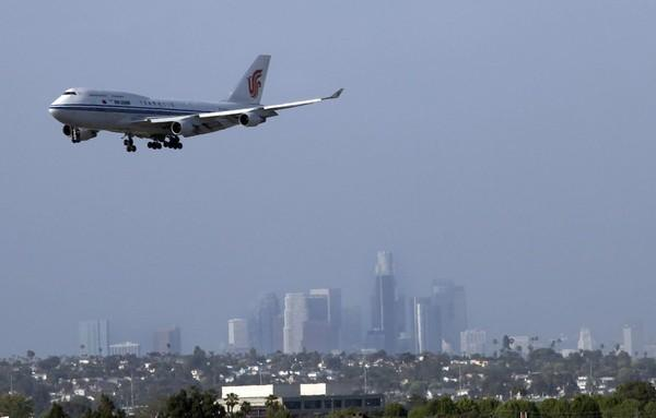 A 747 comes in for a landing at LAX with the downtown skyline as a backdrop. The best spots to watch planes? El Segundo's Imperial Hill area and next to the In-N-Out Burger on Sepulveda Boulevard.