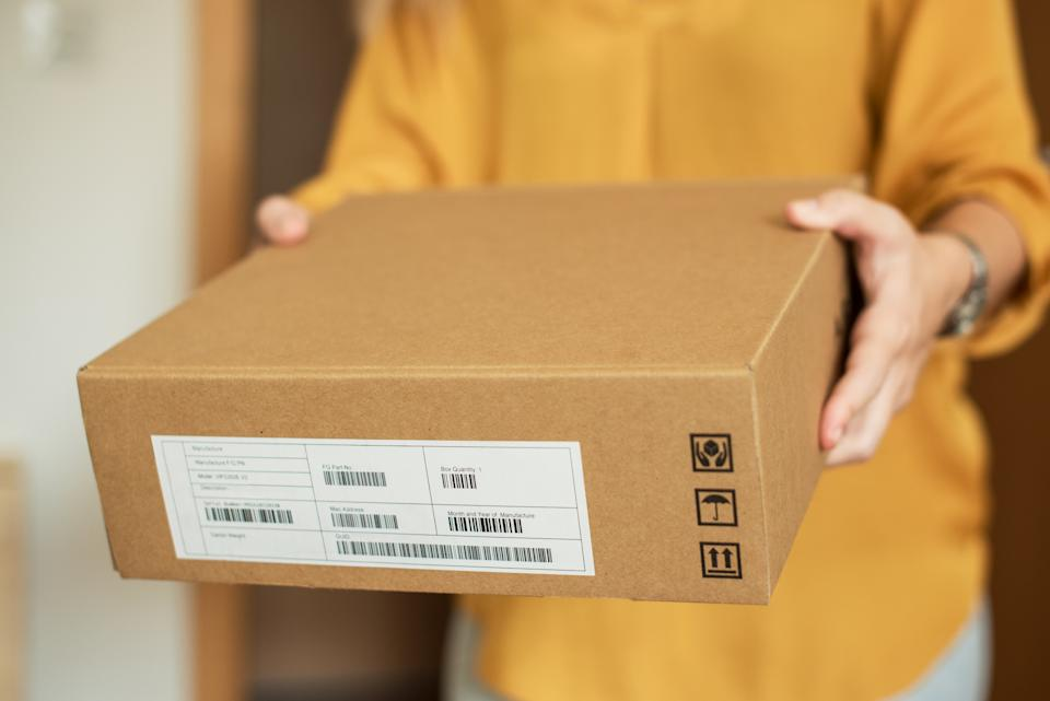 Close up of young woman receiving a package