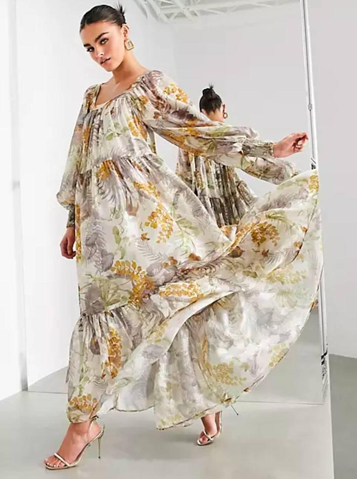 """Floral print doesn't have to mean bright. Take it from this pretty neutral option that will blow in the wind just right. $135, ASOS. <a href=""""https://www.asos.com/us/asos-edition/asos-edition-oversized-maxi-dress-in-floral-satin-burnout-with-square-neck/prd/22046652"""" rel=""""nofollow noopener"""" target=""""_blank"""" data-ylk=""""slk:Get it now!"""" class=""""link rapid-noclick-resp"""">Get it now!</a>"""