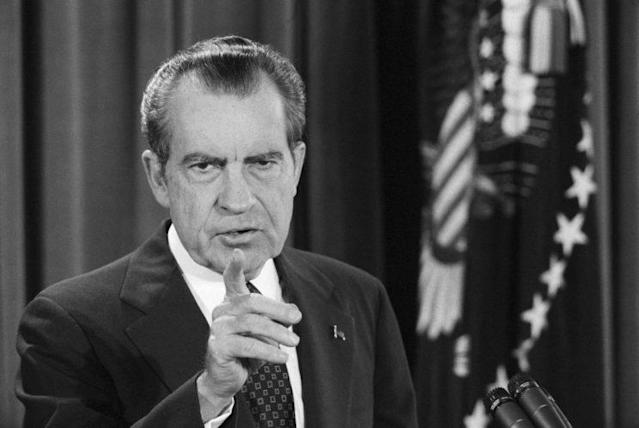 President Nixon points to a reporter during his televised news conference in the East Room of the White House in 1974. (Bettmann)
