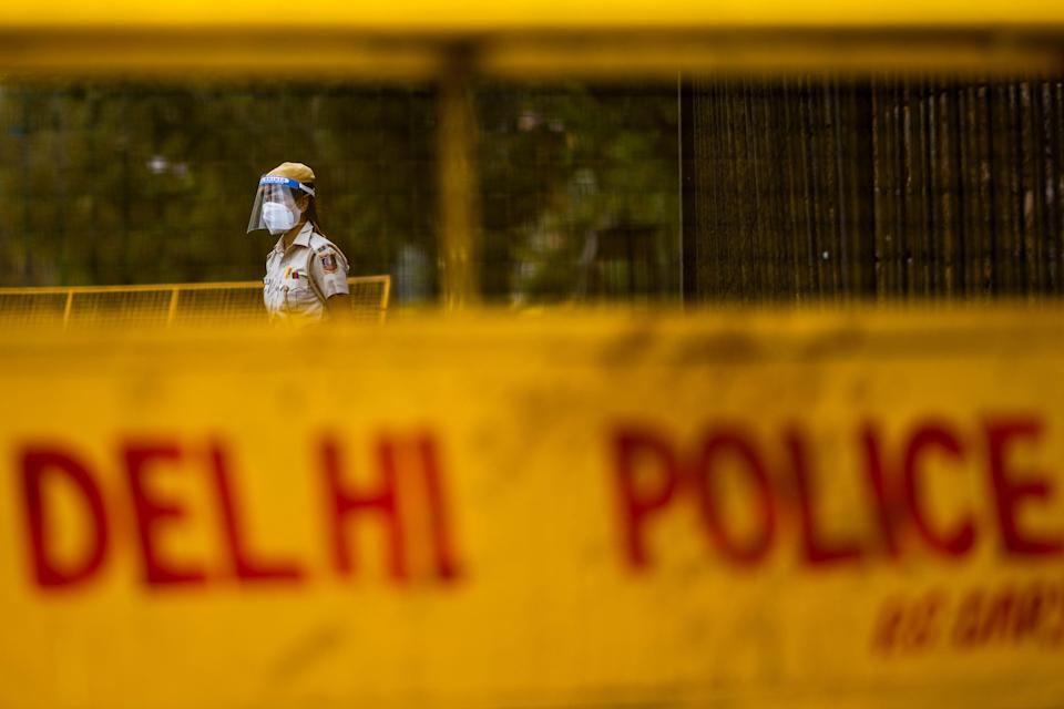 A police officer stands guard at a roadblock in Delhi on 20 April, 2021. Representative image.  (AFP via Getty Images)