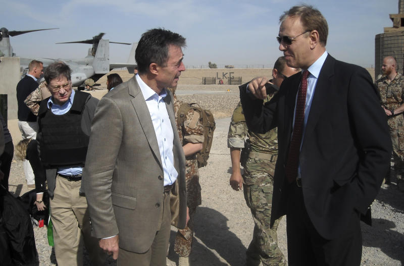 NATO Secretary-General Anders Fogh Rasmussen, left, tours with Maurits Jochems, right, NATO ambassador to Afghanistan, the ISAF headquarters Task Force Helmand, Tuesday, March 5, 2013. NATO's chief is embracing a proposal to keep 352,000 Afghans in uniform through 2018 — about 122,000 more than originally planned. (AP Photo/Kimberly Dozier)