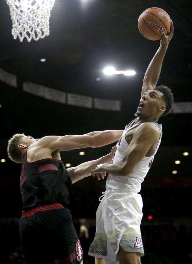 Arizona guard Allonzo Trier (35) shoots over Stanford forward Reid Travis during the second half of an NCAA college basketball game Thursday, March 1, 2018, in Tucson, Ariz. Arizona defeated Stanford 75-67. (AP Photo/Rick Scuteri)