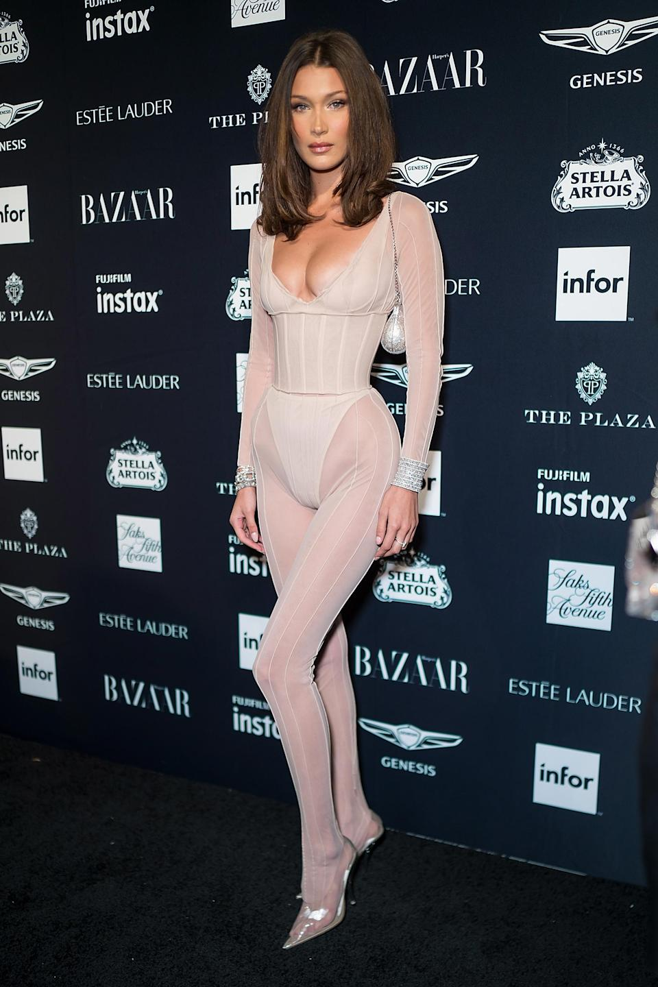 <p>Never one to shy away from the near-naked trend, the supermodel wore a leotard and sheer tights to the <em>Harper's Bazaar</em> Icons party on September 7. <em>[Photo: Getty]</em> </p>